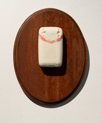 Trophy. Soap, lipstick, wood, varnish, 12 x 9 x 2 in. (one of three). 2009