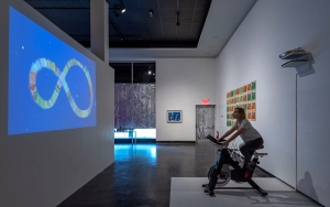 Ouroboros (For Kekulé), interactive installation with animation controlled by viewers riding a stationary bike, 2019